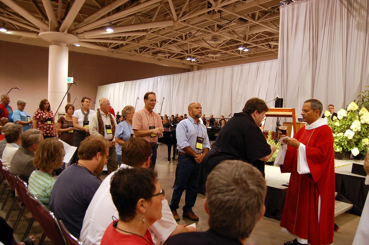 Vice-President Carlos Pena distributing Holy Communion.