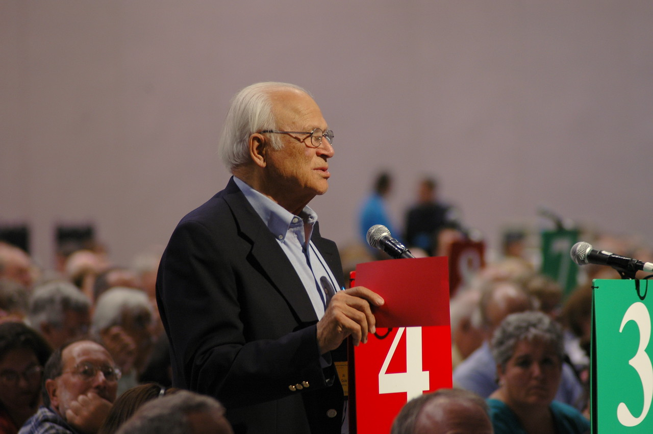 A voting member speaks in opposition to an amendment.