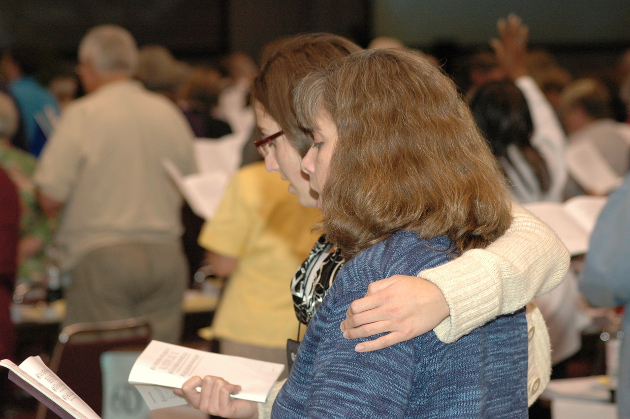 Voting members sing after the Committee of the Whole discussion on our evangelical mission.