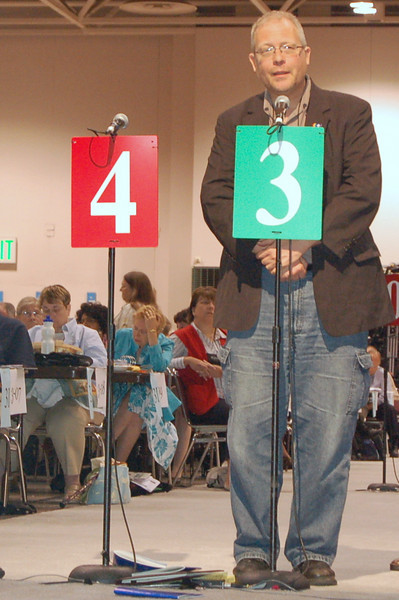 A voting member speaks to an issue during plenary session ten.