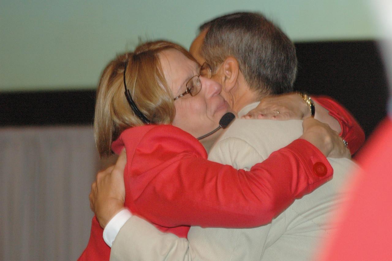 Kathy Bender-Schwick congratulates Carlos Peña after his re-election.