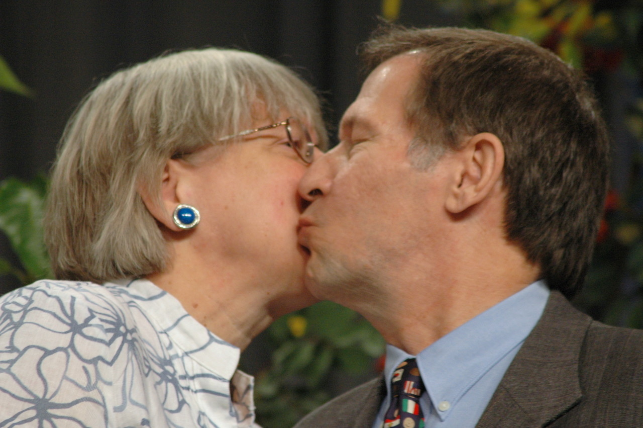 Retiring Lutheran Immigration and Refugree president, Ralston H. Deffenbaugh, Jr. kisses his wife after being thanks by the assembly for a life of service.