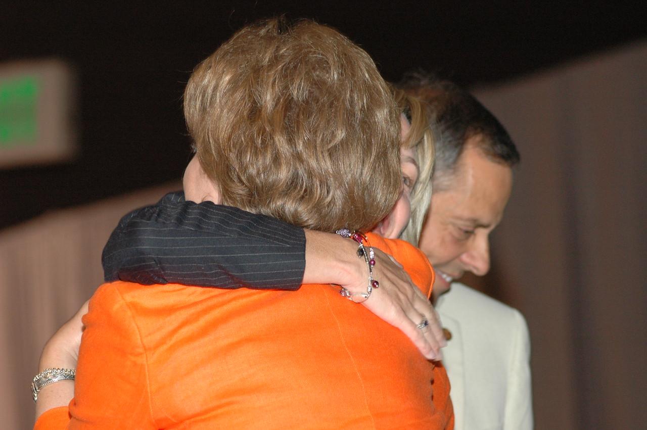 Christina Jackson-Skelton, ELCA Treasurer, hugs Diana Peña.