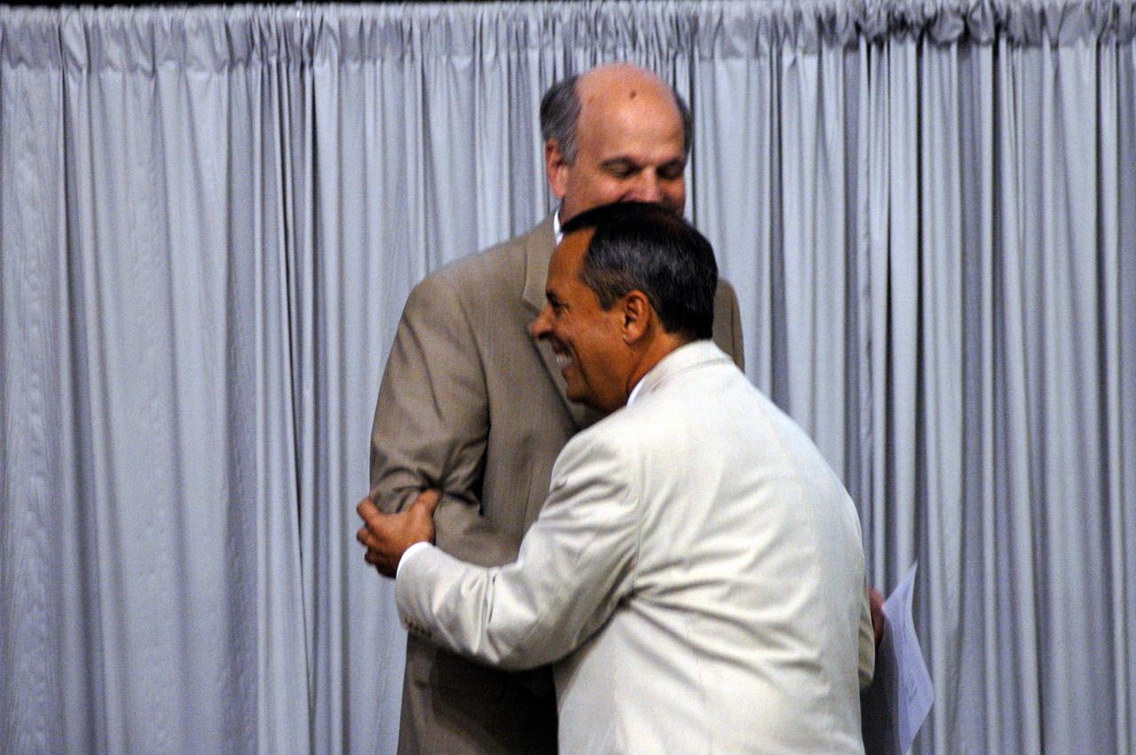 Phil Harris, ELCA general counsel, congratulates Carlos Peña on his re-election.