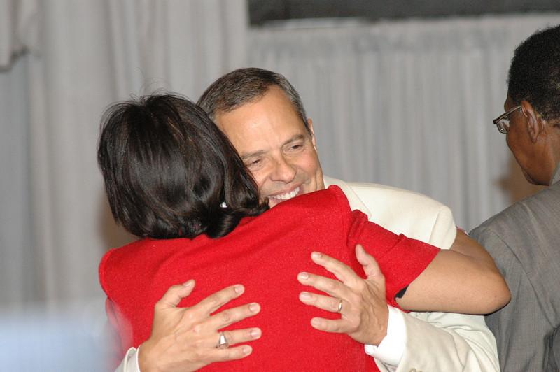 Wyvetta Bullock congratulates Carlos Peña after he is re-elected.