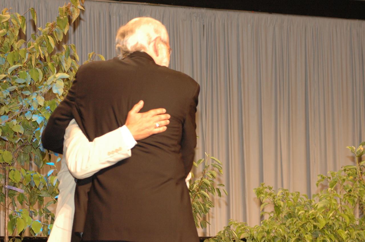 Hanson hugs Carlos Peña after his re-election to Vice President of the ELCA.