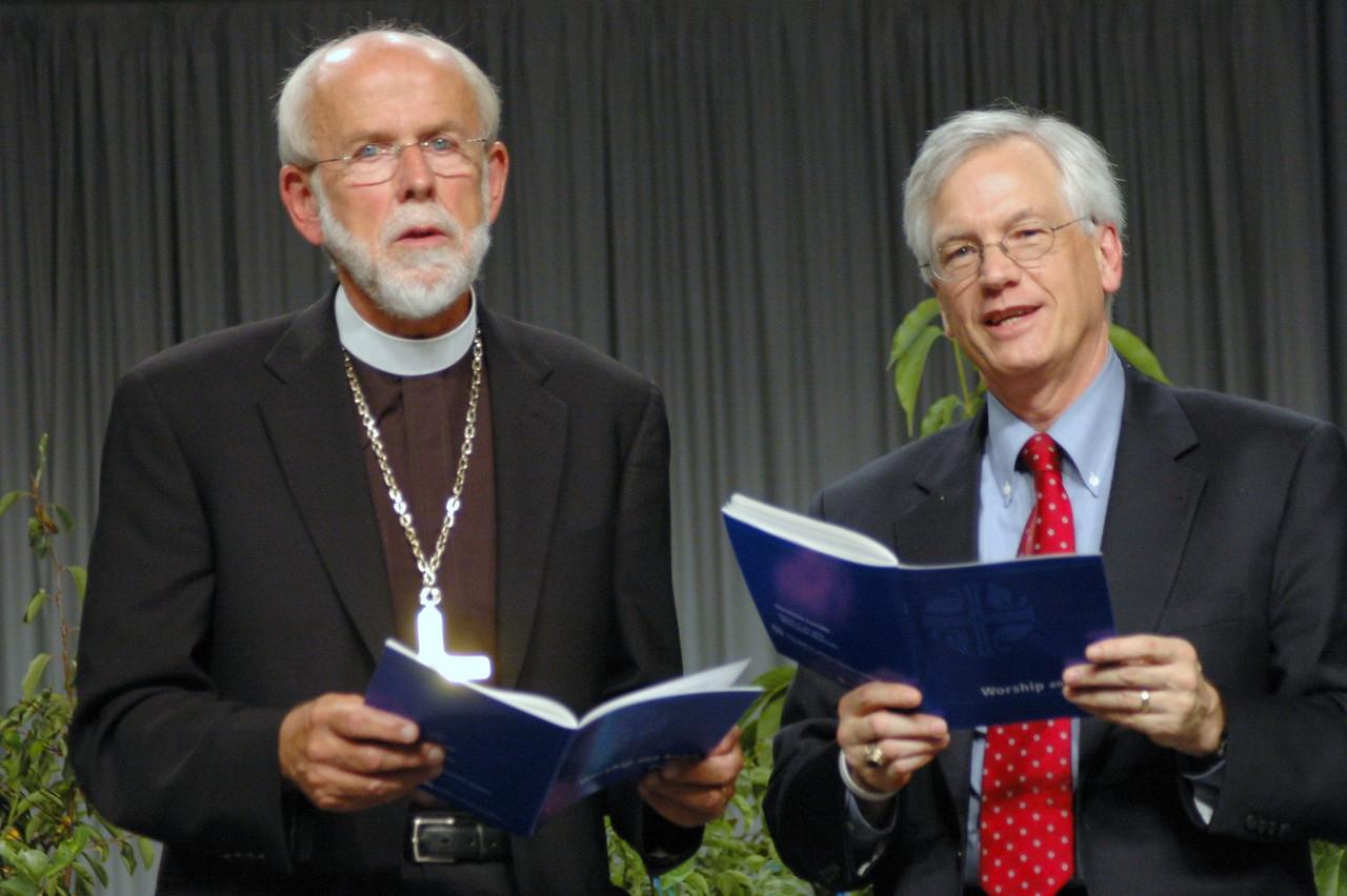 Bishop Hanson and Secretary Swartling close Plenay 11 with song.