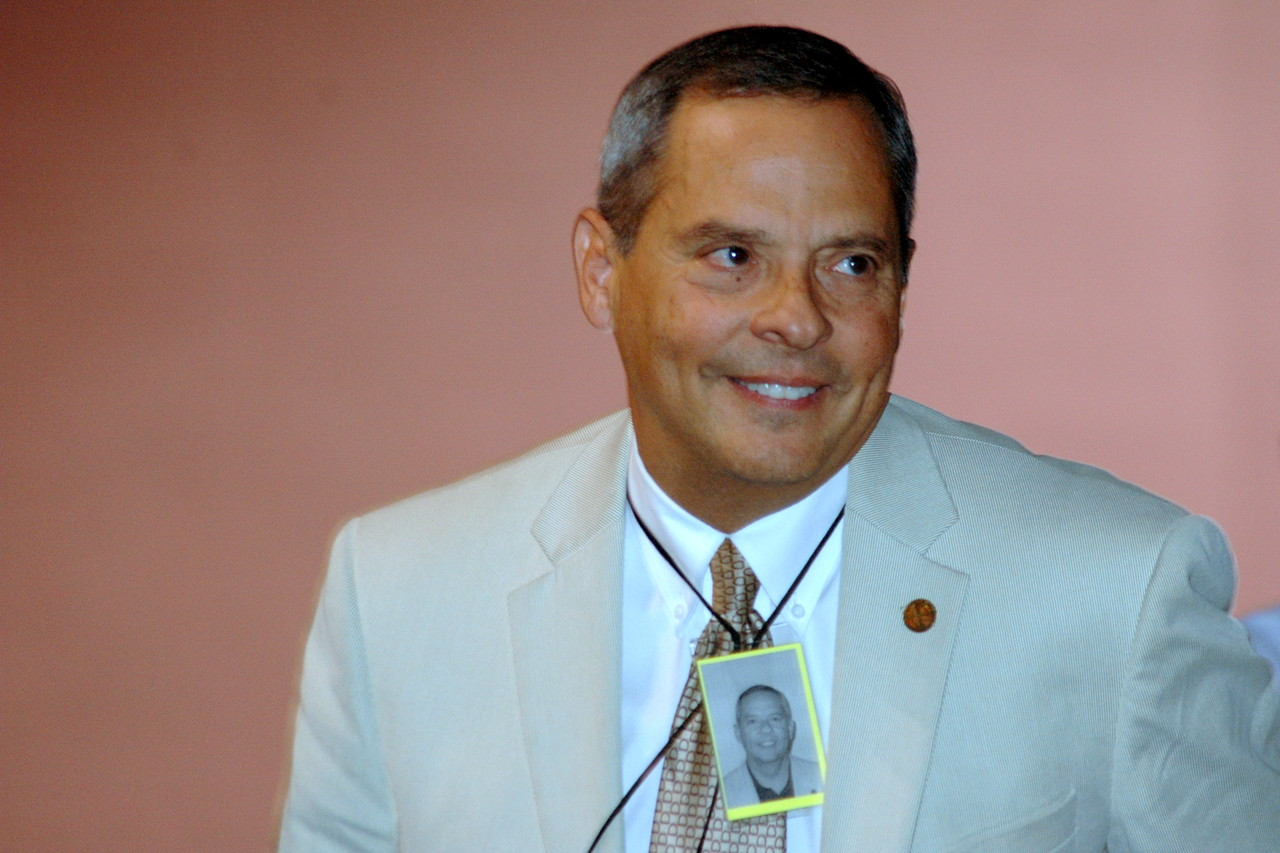 Carlos Peña, ELCA Vice President smiles as he hears the announcement of his re-election.