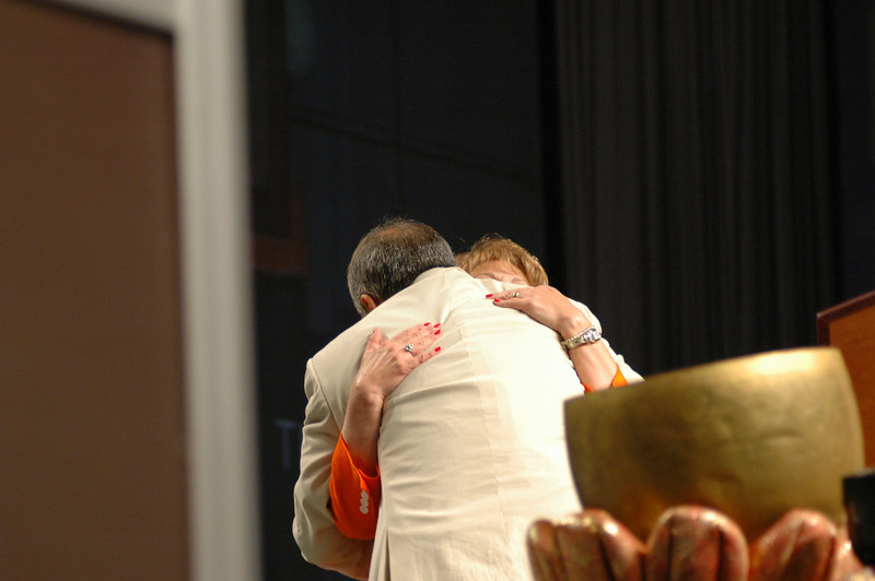 Carlos embraces his wife Diane after his re-election.