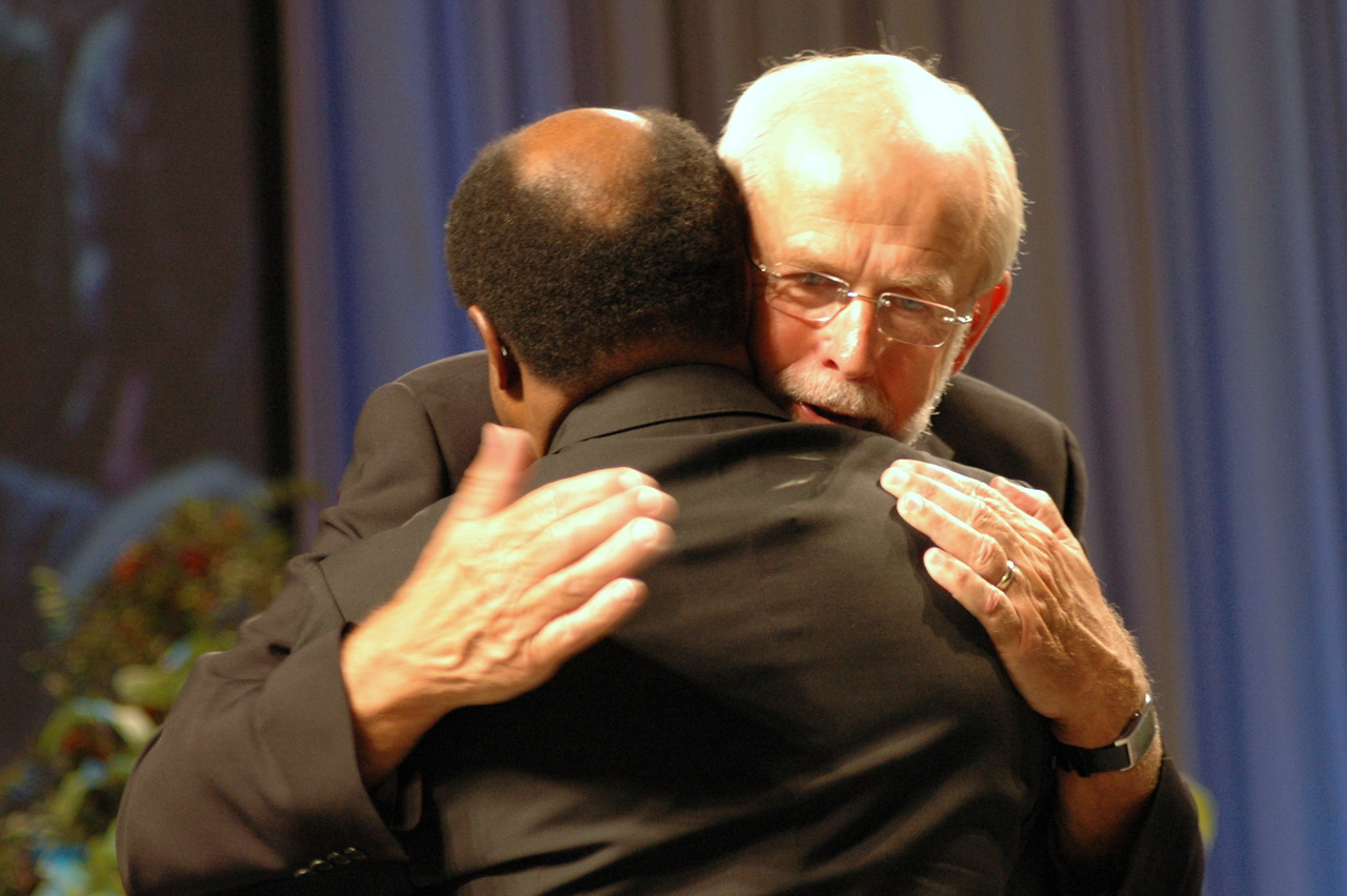 Presiding Bishop Mark S. Hanson embraces Dr.Ishmael Noko, secretary of the Lutheran World Federation