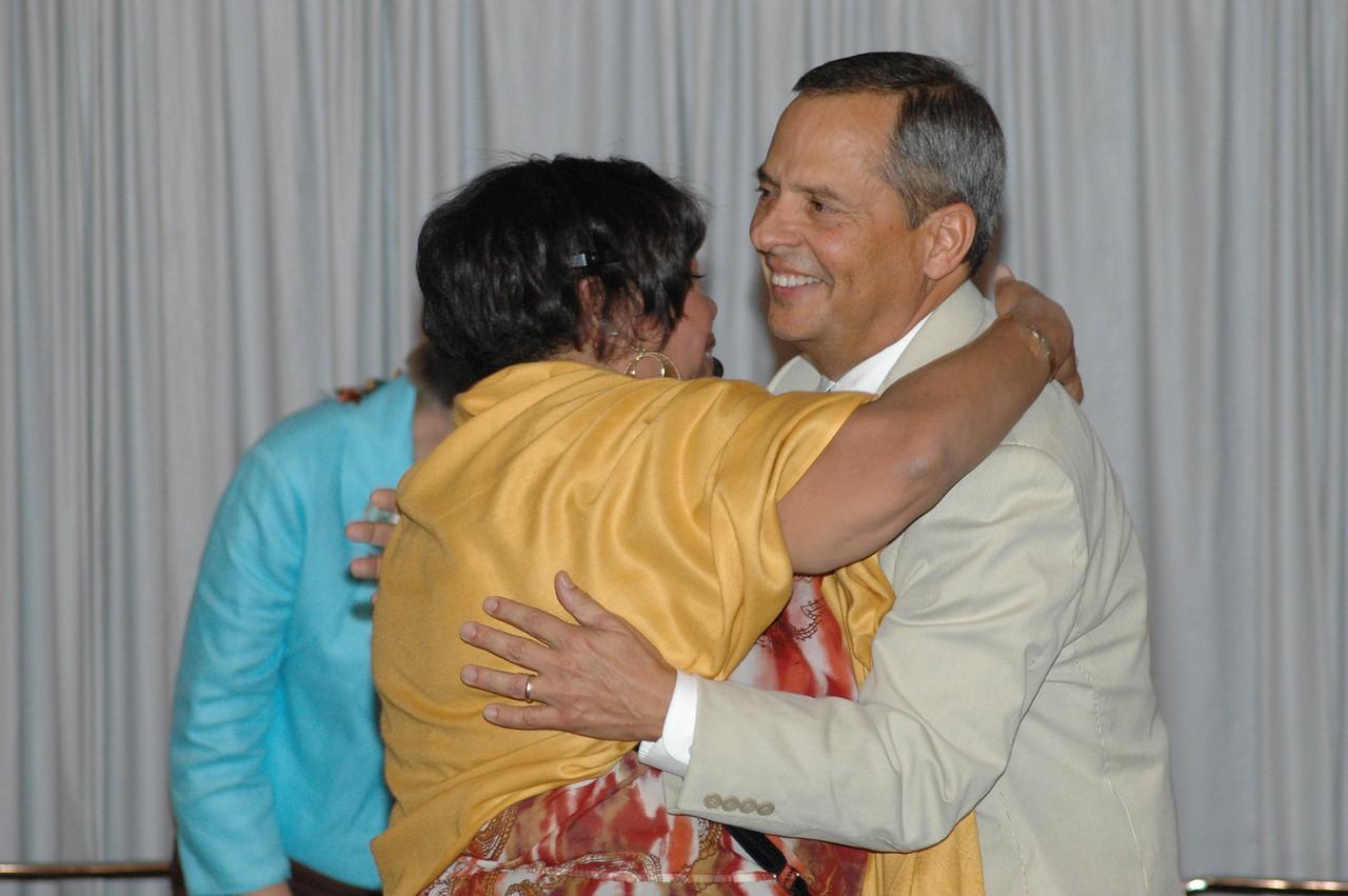 Ava Martin congratulates Carlos Peña on his re-election.