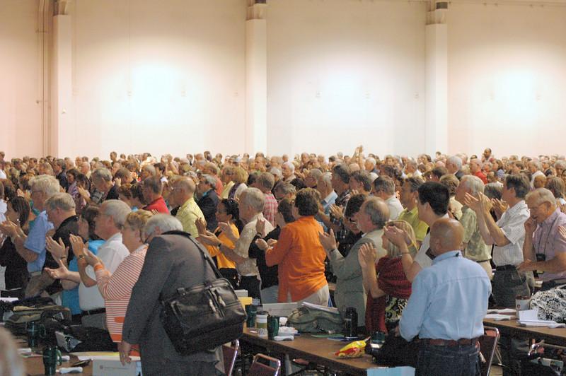 Voting members applaud Bishop Hanson for his leadership this week.