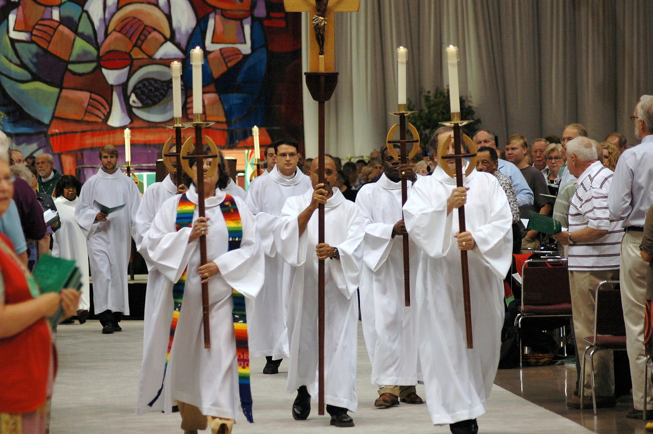 Procession to the font during closing worship.