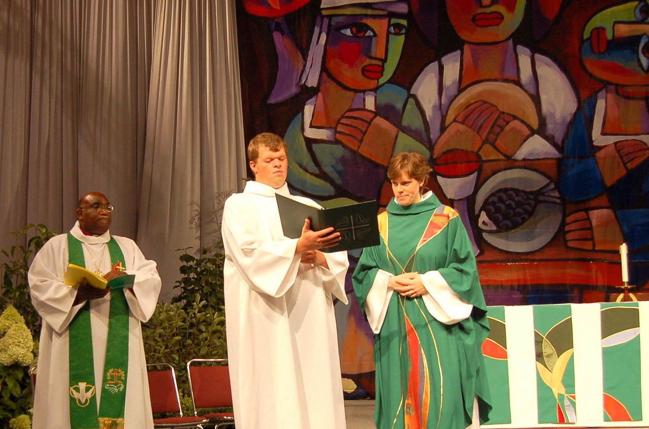 The Rev. Callista Isabelle, presiding minister, assisted by Will Esch
