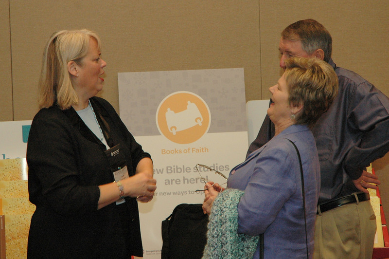 Leslee Nestingen from Augsburg Fortress Publishers discusses Book of Faith resources with assembly participants.