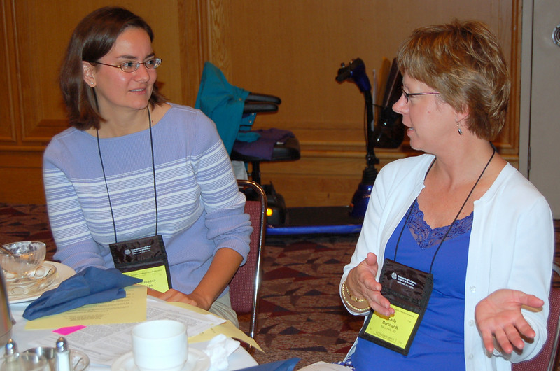 Carla Borchardt explains her position to a fellow voting member.