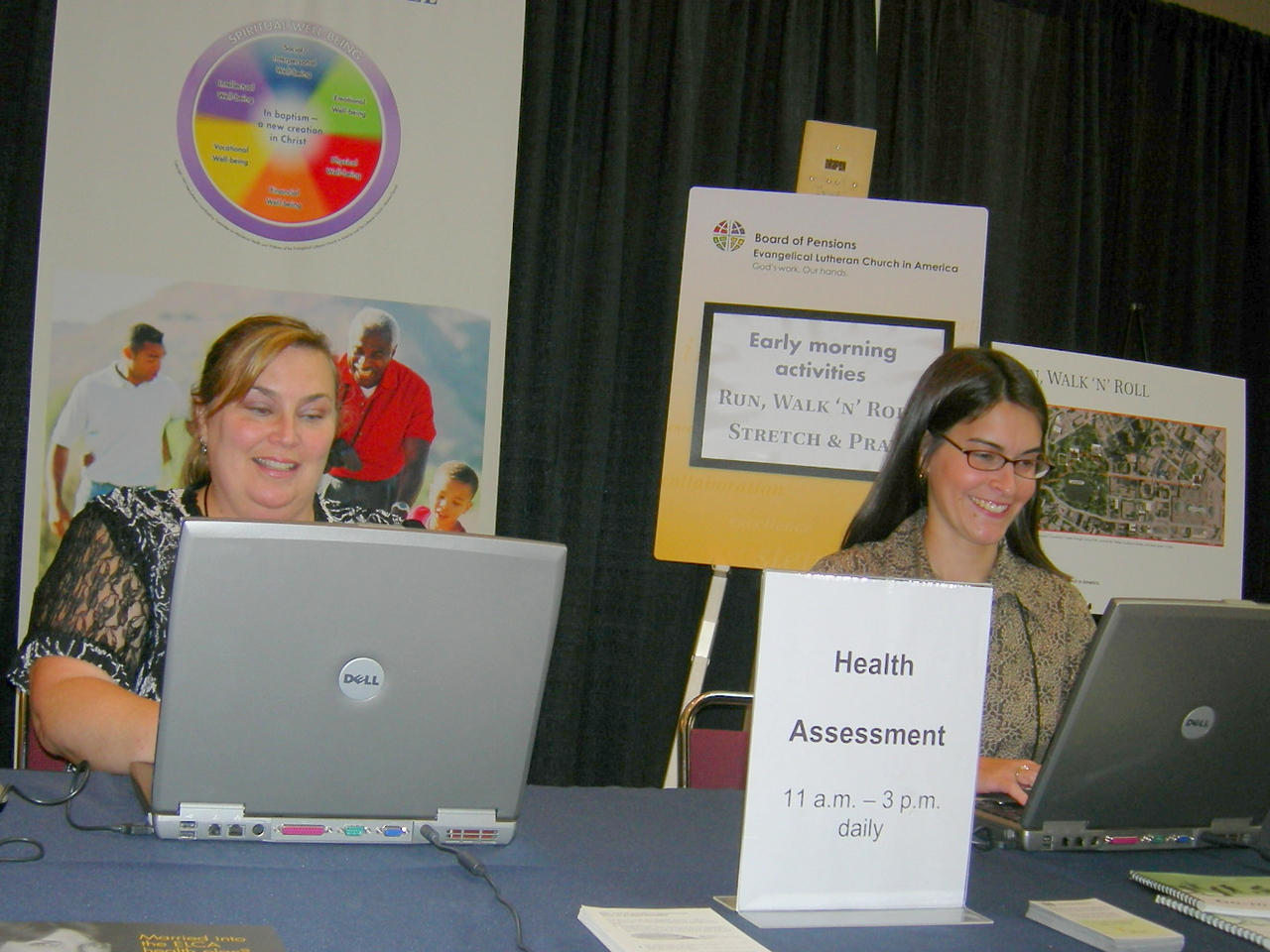 Teresa Gonyer and Connie Clausen of the ELCA Board of Pensions assist plan members sign-up for the Health Assessment.