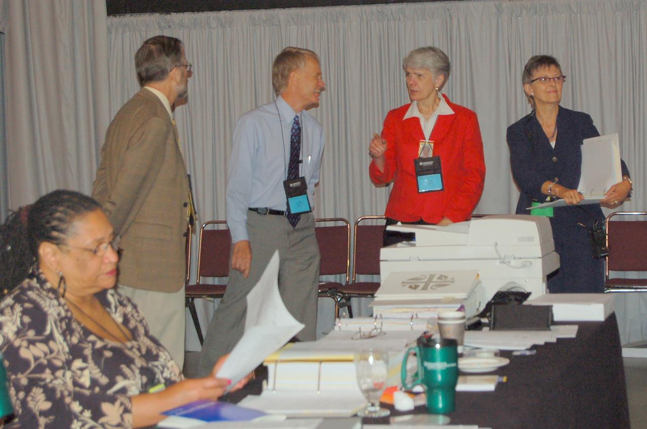 The Rev. Craig Settlage, the Rev. Stan Olson, Myrna Sheie, and Kristi Bangert. Violet Bonner is in the foreground.