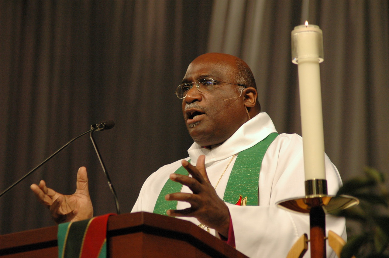 Bishop Gregory Palmer illustrates a point in Thursday's homily.