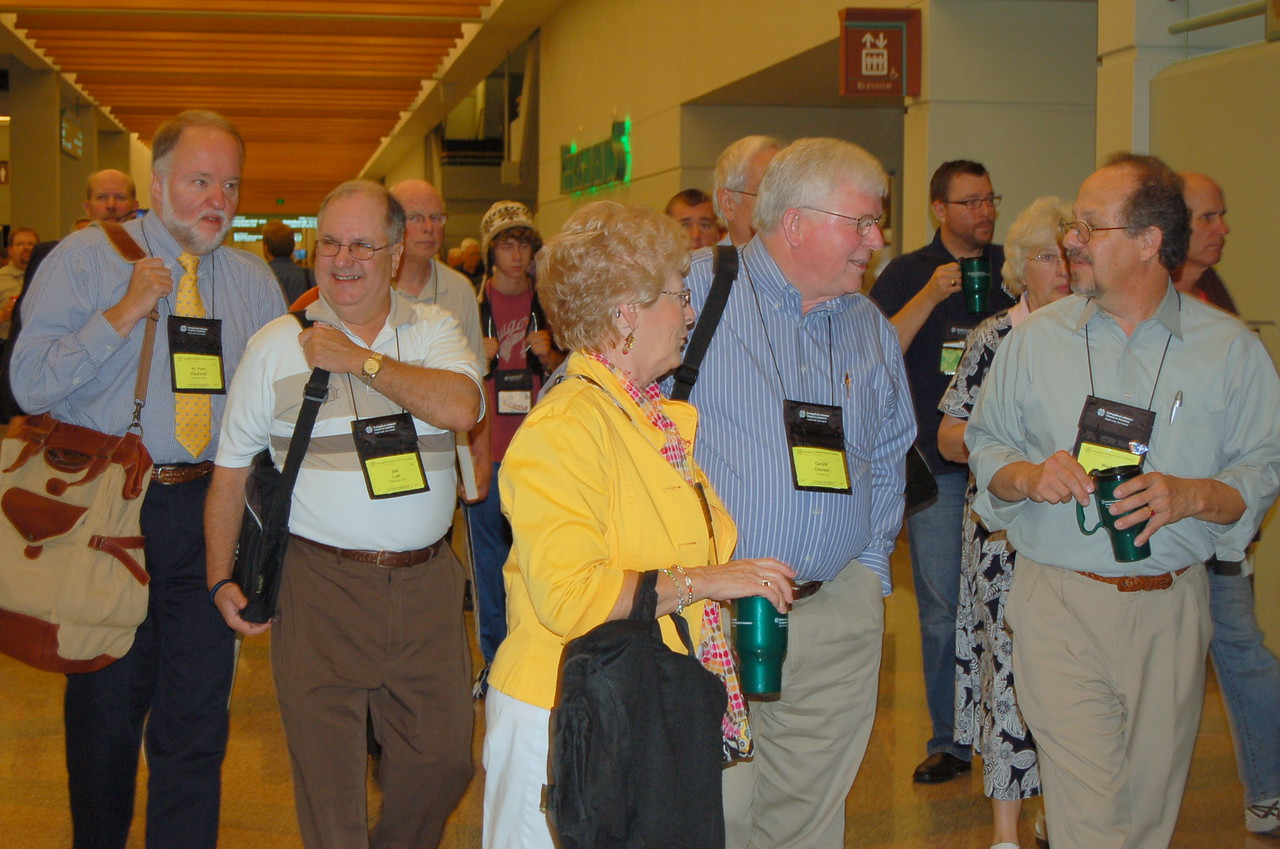 Voting members on their way into plenary session.