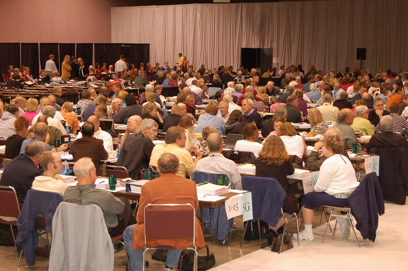 Voting members at plenary session seven in their small group discussions for the bible study.