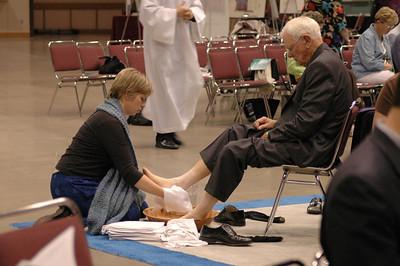 Worships take turns washing one another's feet.