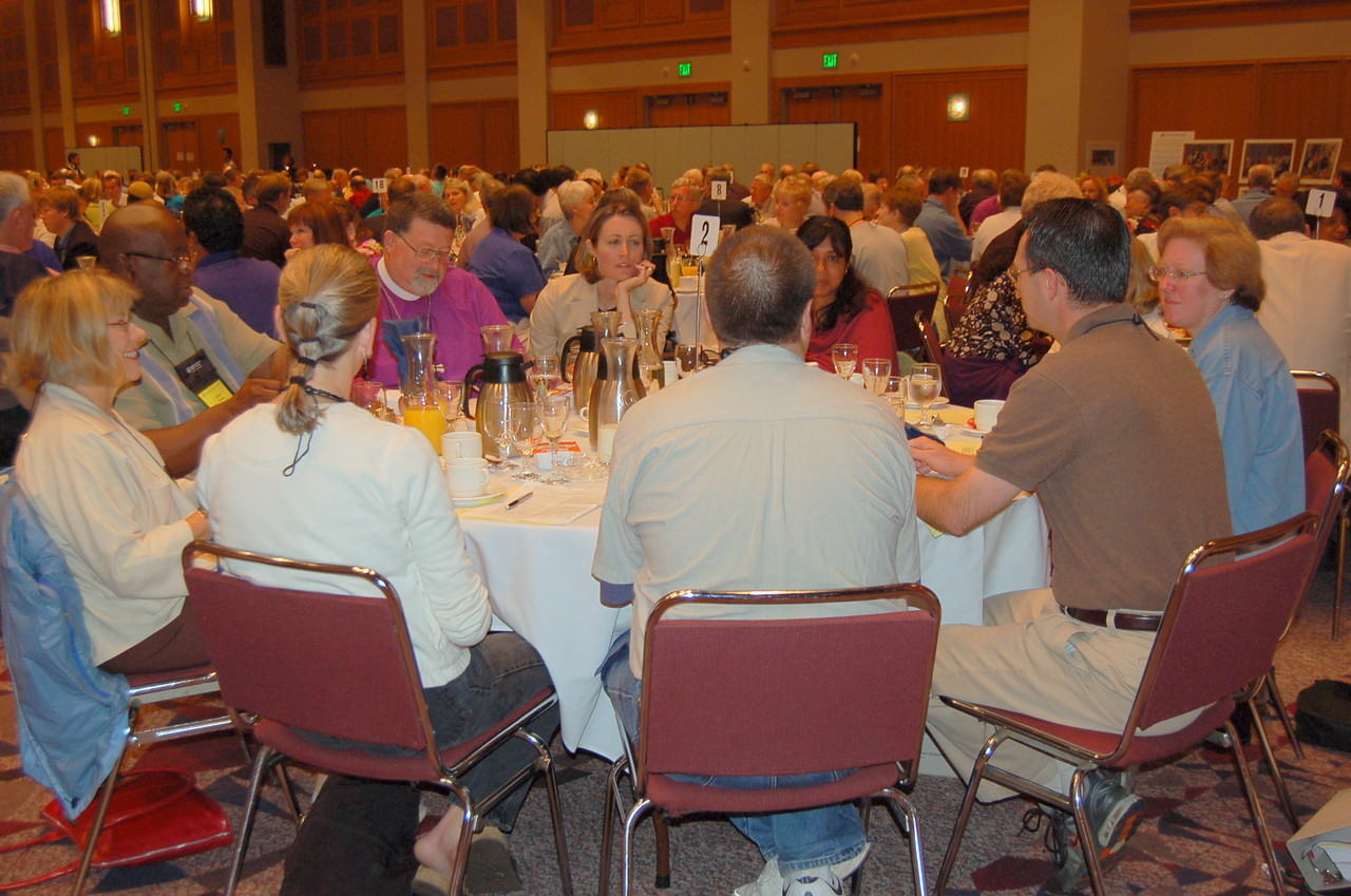 Voting members meet in roundtable discussions.