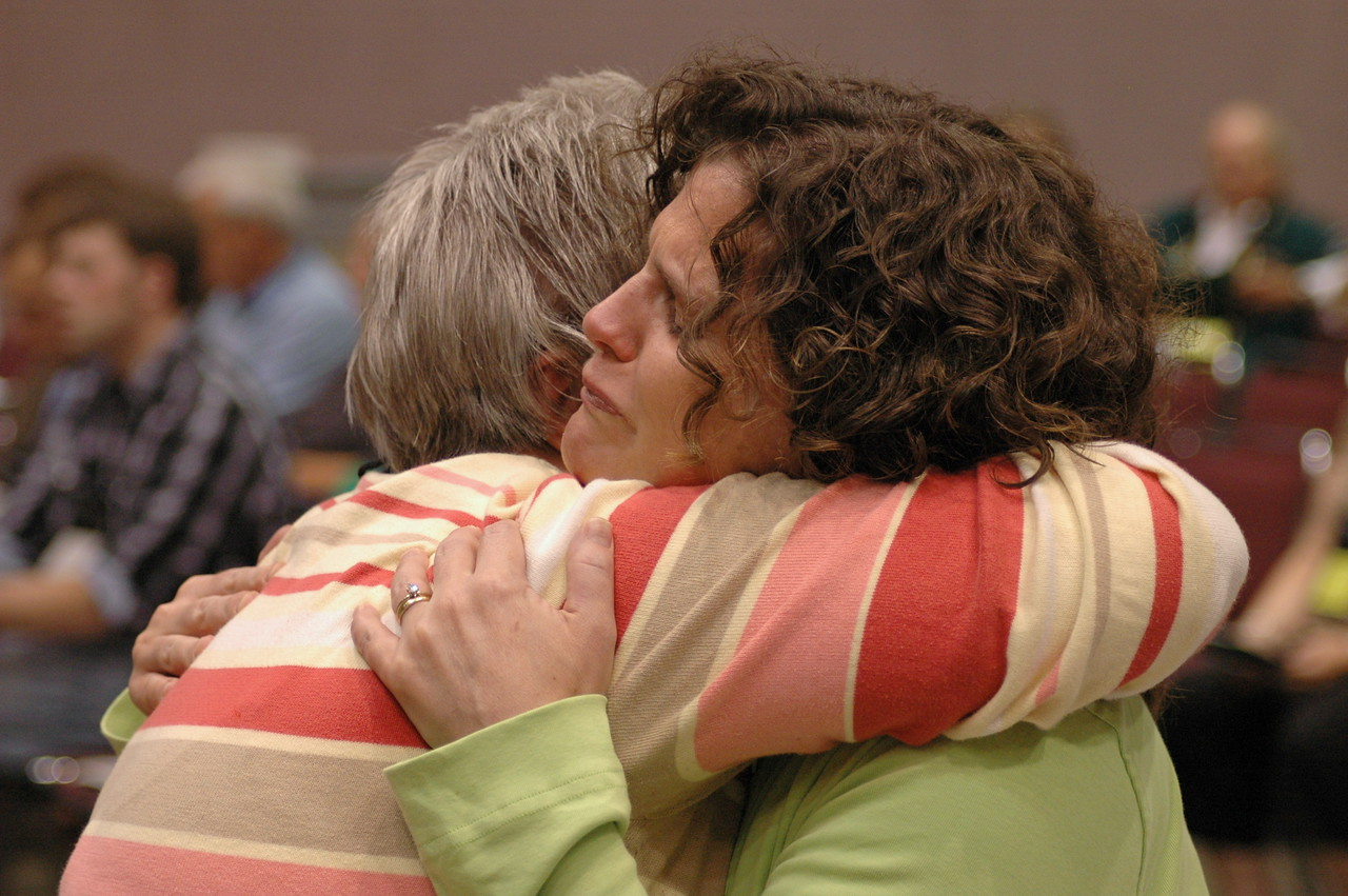 Exchanging the peace at Thursday's worship.