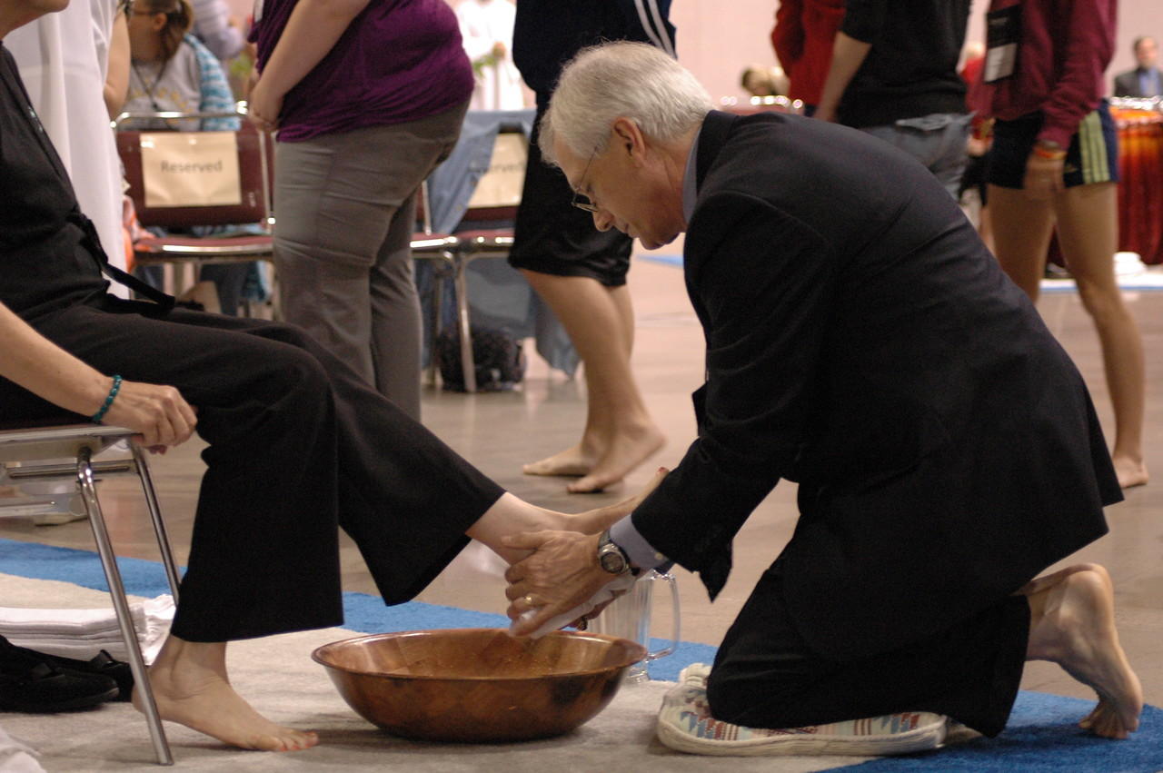 Secretary of the ELCA, David Swartling washes the feet of a fellow worshiper.