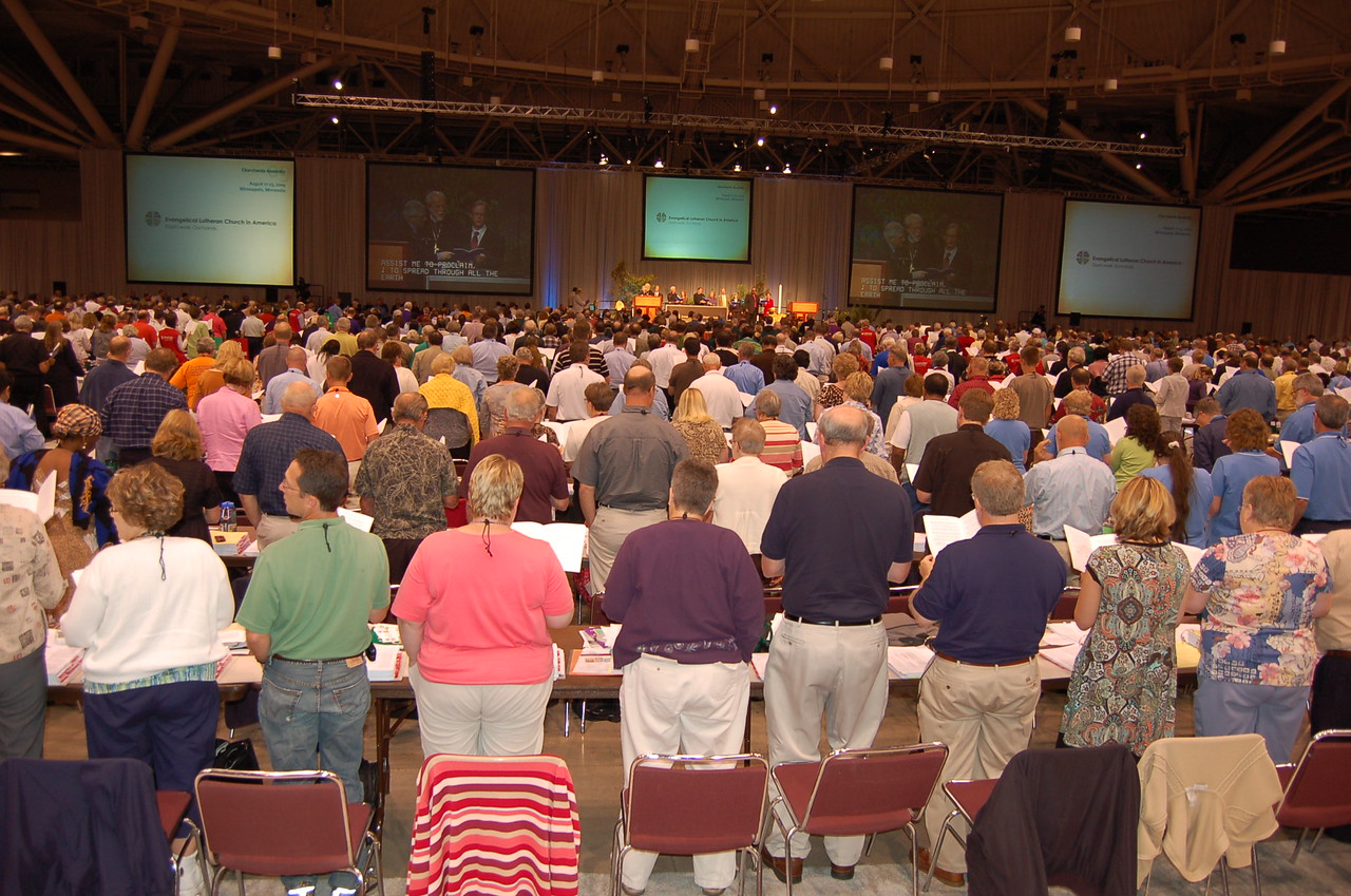 Assembly members rise in singing after the recent adoption of the UMC full communion agreement.