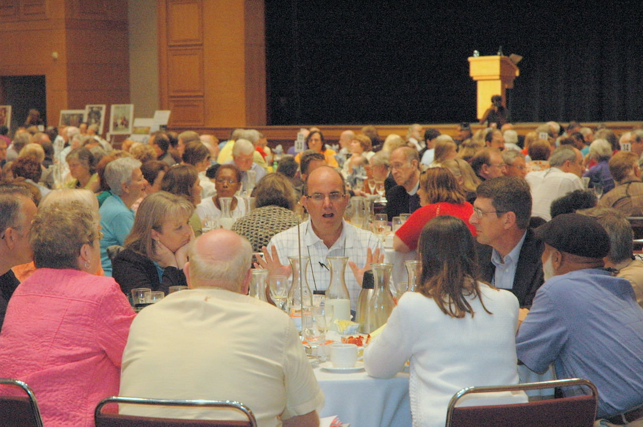 Voting members enjoy lively table conversations at Thursday lunch.