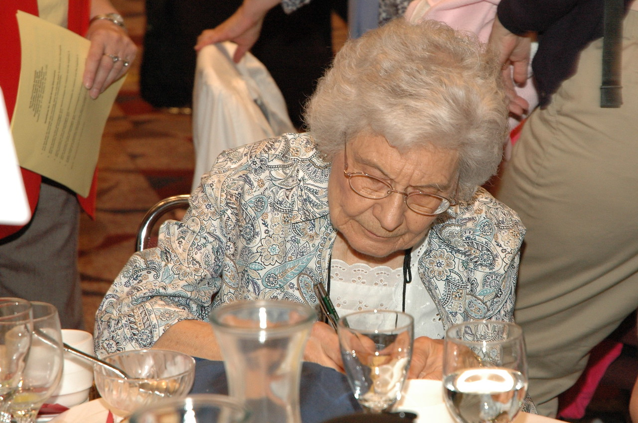 Oldest voting member, Phyllis Score, Atonement Lutheran, Bloomington, MN focuses on assembly business.