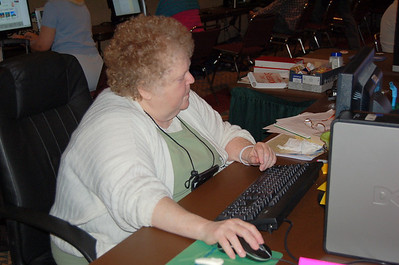 Mim Woolbert assists assembly participants in the e-mail center.