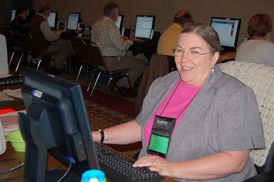 Linda Lovell staffs the e-mail center.