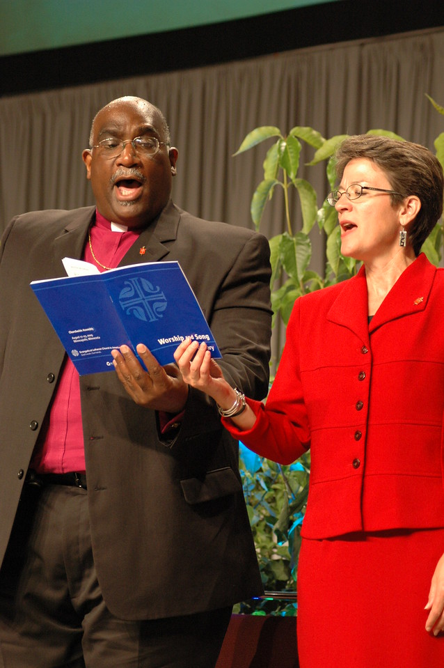 Bishop Gregory Palmer (President, Council of Bishops, United Methodist Church), and Bishop Sallya Dyck (United Methodist Church's North Central Jurisdiction, Episcopal are of Minnesota)  sing a favorite hymn of Methodists and Lutherans.