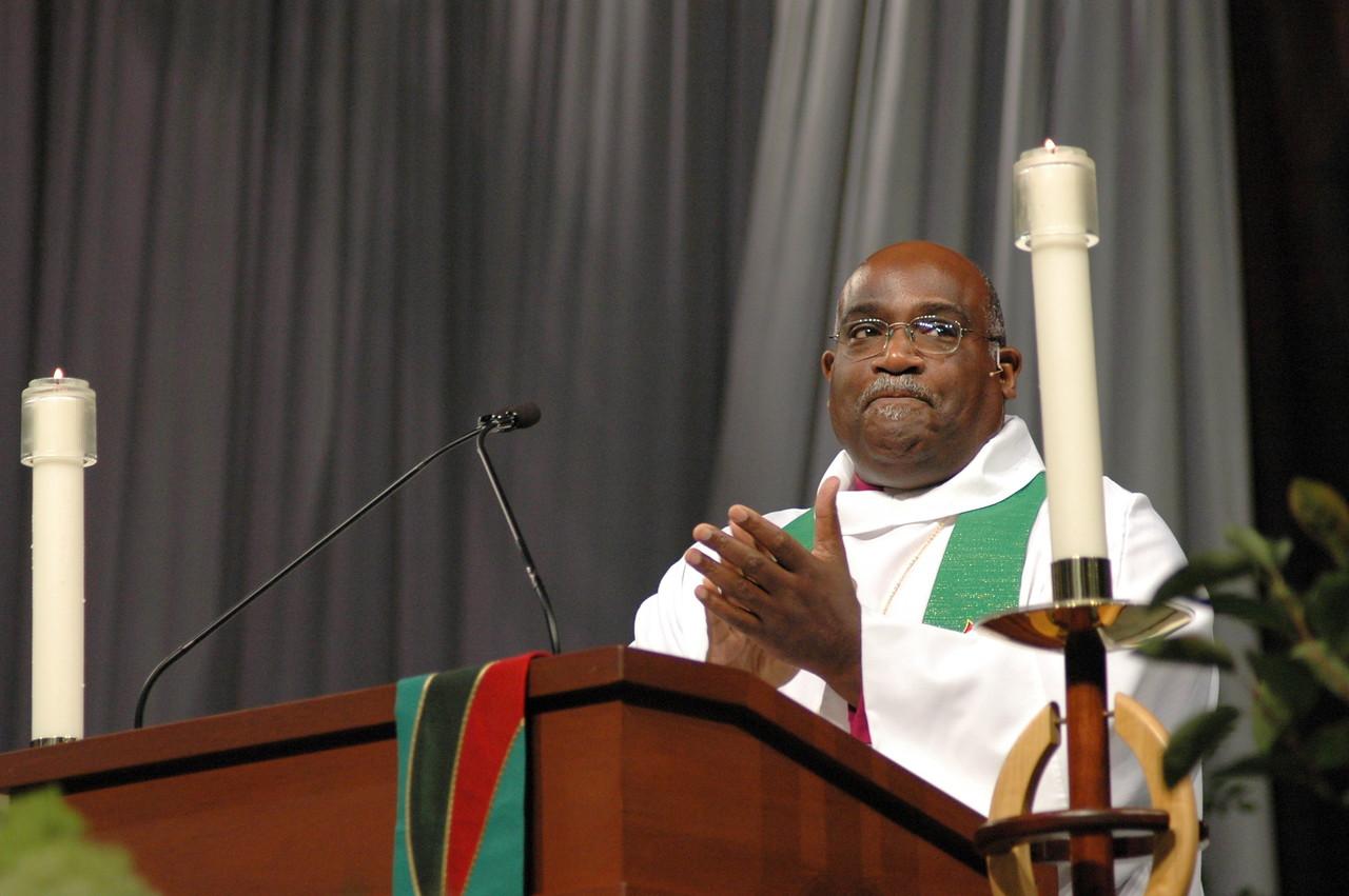 Bishop Gregory V. Palmer invites applause for Bishop Mark Hanson's leadership.