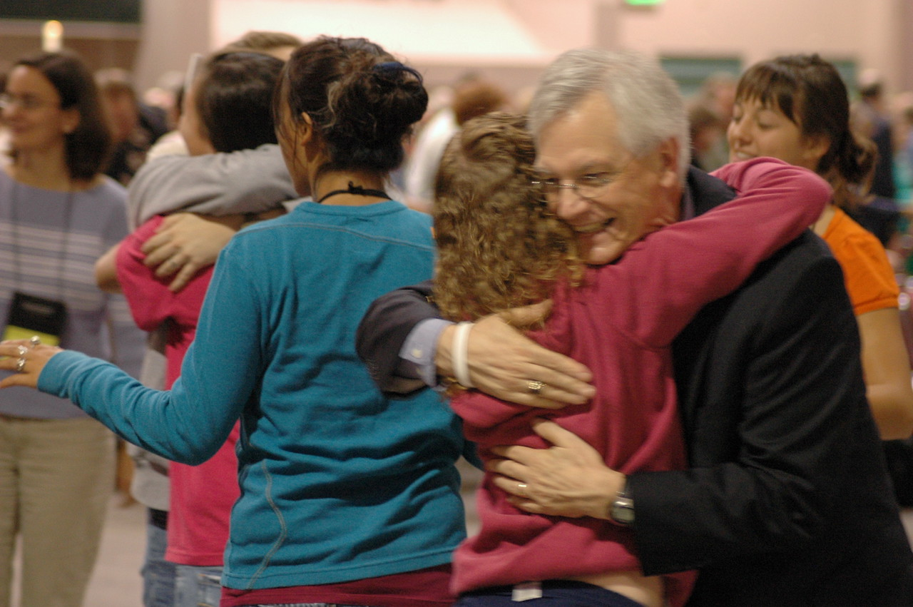 Secretary of the ELCA, David Swartling exchanges hugs with Youth Convocation participants.