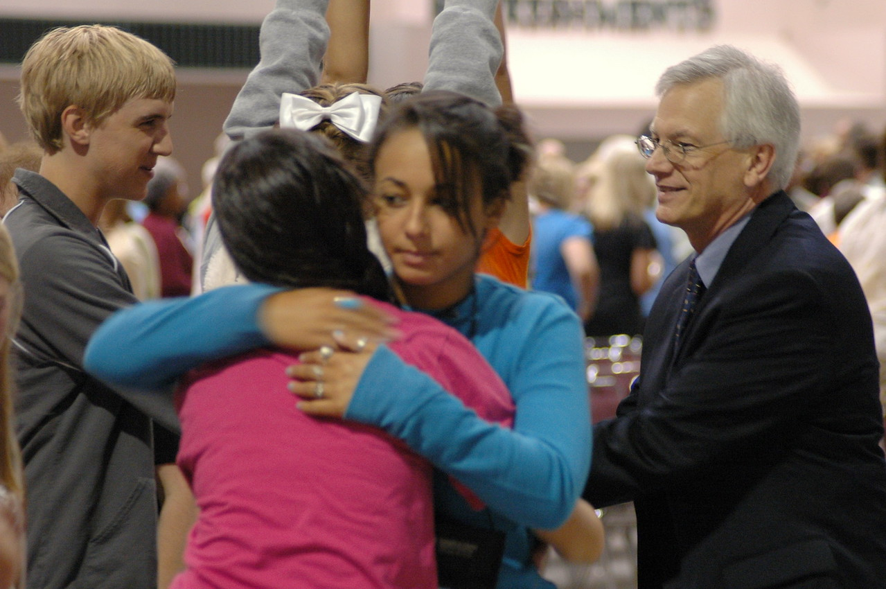 Youth Convocation participants exchange the peace with one another and with David Swartling, Secretary of the ELCA.