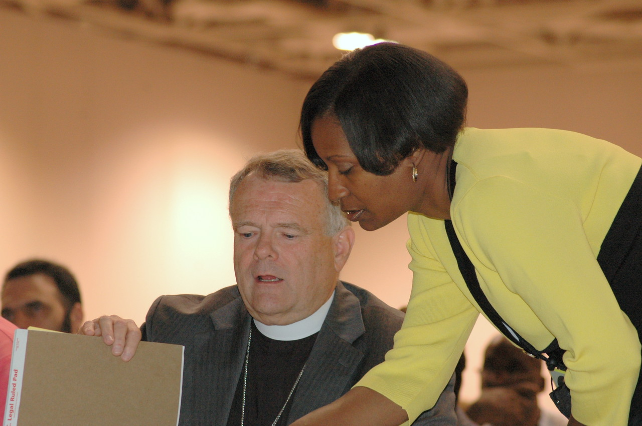 Tammy Jackson, director for International Leadership Development, ELCA Global Mission confers with Bishop Roy  Riley from the New Jersey Synod.