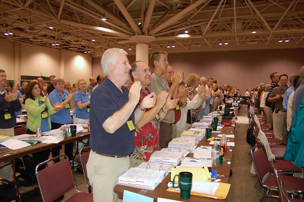 Voting members applaud the adoption of the UMC Full Communion agreement.