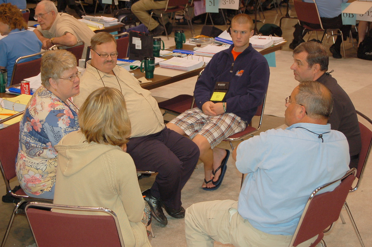 Voting members discuss the bible study questions in a small group setting.