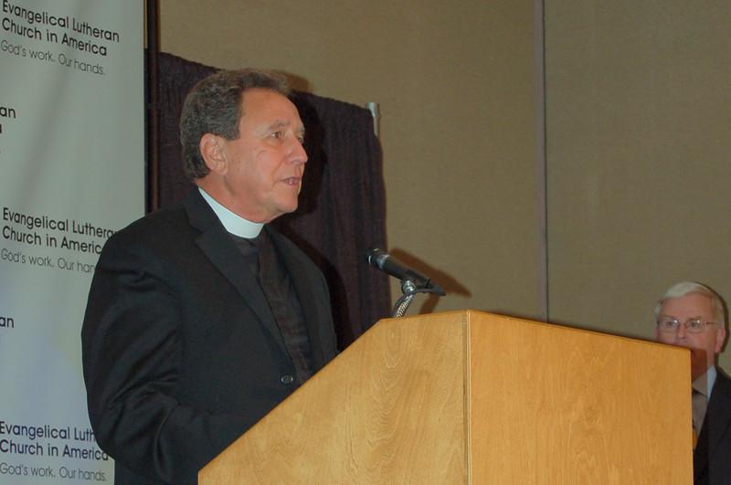 Pr. Dan McCoid, executive, ELCA Ecumenical and Inter-Religious Relations, John Brooks, director for ELCA News Service, looks on.