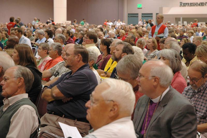 Voting members in worship.