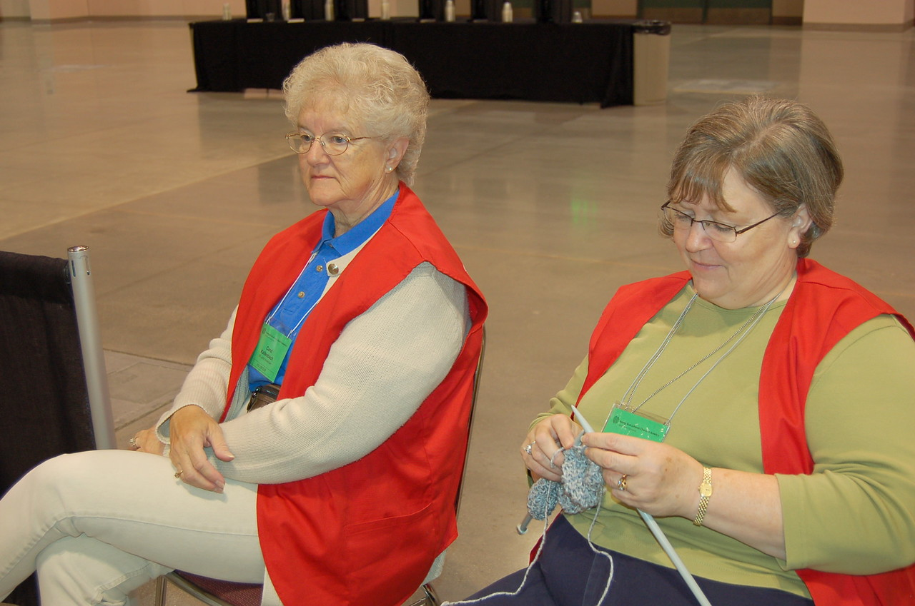 Assembly volunteers listen to the proceedings of plenary session two.