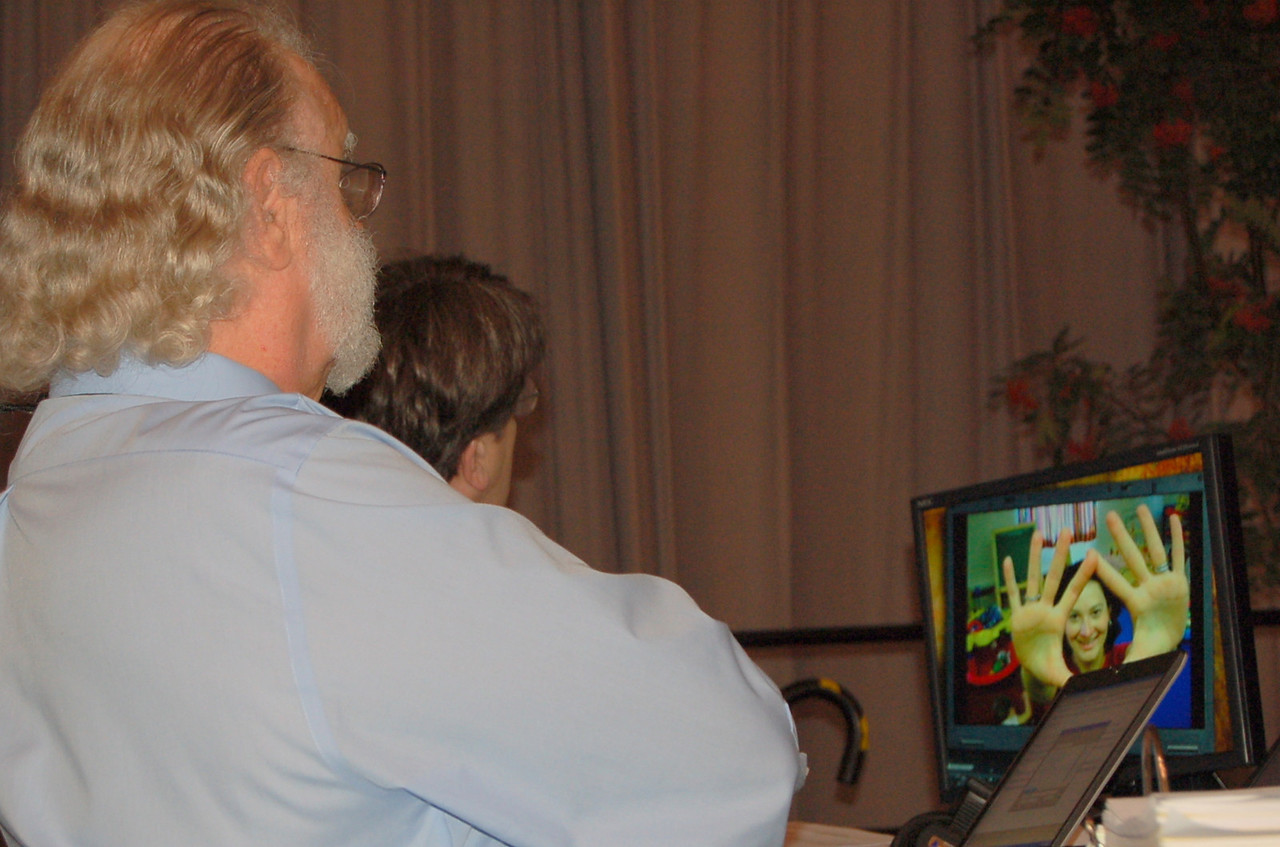 Parlimentarian, the Rev. Lyle A. Kleman, watches a video contest submission.