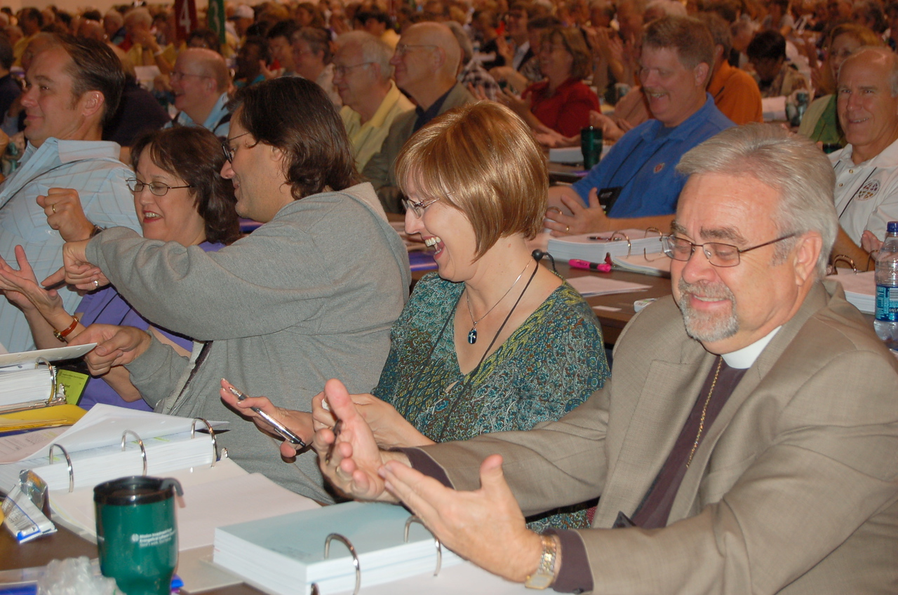 """Bishop Hanson asked the assembly to look at their hands. He asked them what in the last three weeks has God been doing through their hands, referring to the ELCA's tagline, """"God's work. Our hands."""""""