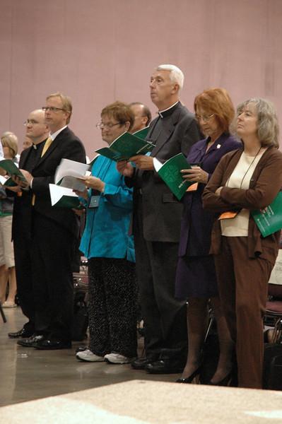 Former Secretary of the ELCA, Lowell Almen singing in worship.