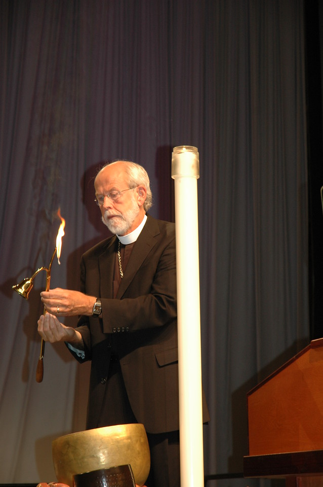 Presiding Bishop Hanson lights the candle and announces the 2009 Churchwide Assembly open (and quickly learns which way the tab slides to extinguish the flame!)