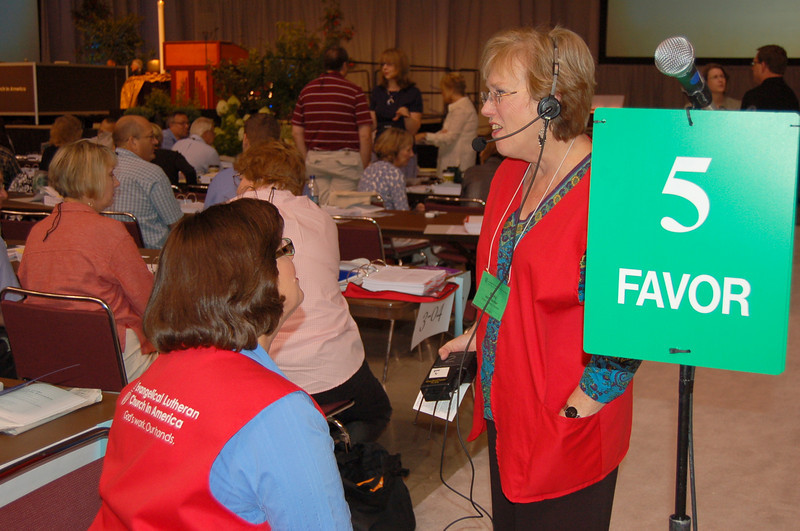 Volunters at a microphone station.