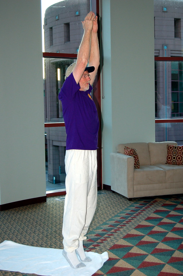 The Rev. Murray Finck, bishop, Pacifica Synod begins the morning Stretch and Pray reaching up to stretch the muscles.
